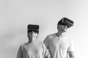 White couple experiencing virtual reality with VR headset